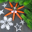 Beautiful snowflakes with fir branch on wooden background — Stock Photo #45052869