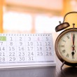 Alarm clock  and calendar on bright background — Stock Photo #45053951