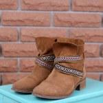 Shoe shelf with women boots — Stock Photo