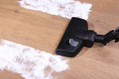 Vacuuming floor in house — Stock Photo