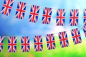 Garland van vlaggen op lichte achtergrond — Stockfoto