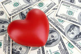 Love and money concept. Heart and American currency close up — Stock Photo