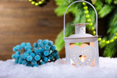 Burning lantern on wooden background — Stock Photo