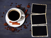 Coffee cup and old blank photos and spices, on wooden background — Stock fotografie