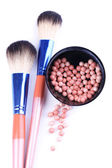 Powder balls and brushes isolated on white — Stock Photo