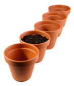 Clay flower pots and soil, isolated on white  — Stockfoto