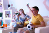 Young couple watching television at home of blacking-out — Stock Photo