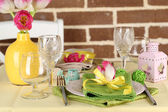 Beautiful spring table setting on bright background — Stock Photo