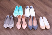Different shoes on floor — Стоковое фото