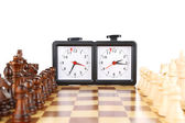 Chessboard with chess and clock, isolated on white — Stock Photo