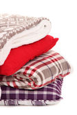 Warm plaids and pillows isolated on white — Stock Photo