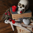 Conceptual photo of love magic. Composition with skull, voodoo doll, dried herbs and candle on  dark wooden background — Stock Photo #45075013