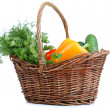 Composition with raw vegetables in wicker basket isolated on white — Stock Photo