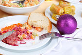 Table with festive dishes after feast close-up — Stockfoto