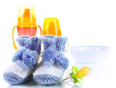 Composition with crocheted booties for baby, isolated on white — Stock Photo