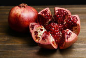 Ripe pomegranates on table close-up — Stock Photo
