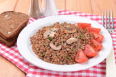 Boiled buckwheat on plate on table close-up — Stock Photo