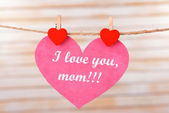Happy Mothers Day message written on paper heart on light background — Стоковое фото