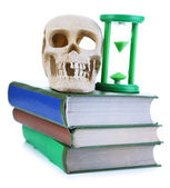 Hourglass and skull on old book isolated on white — Stockfoto