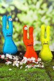 Funny handmade Easter rabbits on green grass — Stockfoto