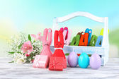 Composition with funny handmade Easter rabbits in wicker basket — Stock Photo
