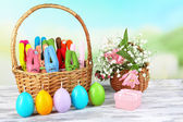 Composition with funny handmade Easter rabbits in wicker basket — Stockfoto