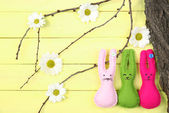 Composition with funny handmade Easter rabbits on wooden background — Stock Photo