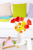 Beautiful spring flowers in vase on home interior background — Stock Photo