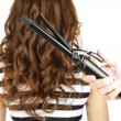 Stylist using curling iron for hair curls, close-up, isolated on white — Stock Photo #45080407