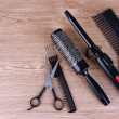 Professional hairdresser tools on wooden background — Stock Photo #45081197