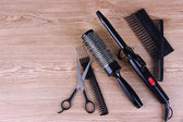 Professional hairdresser tools on wooden background — Stock Photo