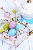 Easter composition with flowering branches on wooden table close-up — Stock Photo