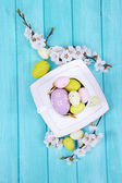 Easter composition with flowering branches on wooden table close-up — Stockfoto