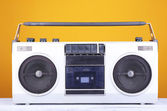 Retro cassette stereo recorder on table on yellow background — Stock Photo