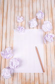 Sheet of white paper with crumpled  paper  and pencil on table close-up — Stock Photo