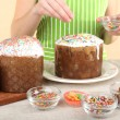 Woman decorating Easter cake, close up — Stock Photo
