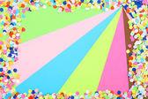 Confetti on colorful background — Stock Photo
