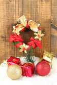 Beautiful Christmas wreath, on wooden background — Stock Photo