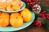 Ripe tangerines in bowl with fir branch close up — Zdjęcie stockowe