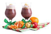 Tasty dessert with chocolate, cream and orange sauce, isolated on white — Stock Photo
