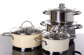 Pans on table on white background — Stock Photo