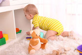 Cute little boy plating in room — Stock Photo