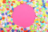 Confetti frame on pink background — 图库照片