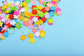 Confetti on blue background — 图库照片