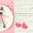 Romantic holiday table setting, on wooden background — Stock Photo #45168381