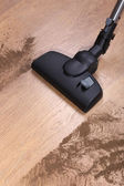 Vacuuming floor in house — Stock Photo