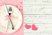 Romantic holiday table setting, on wooden background — Stok fotoğraf