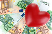 Love for money concept. Heart on European currency — Stock Photo