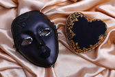 Decorative black heart and mask, on color fabric — Foto de Stock