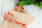 Christmas candy canes and letters for Santa, on color wooden background — Stockfoto